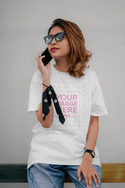 T-Shirt Mockup Featuring Young Woman on Call