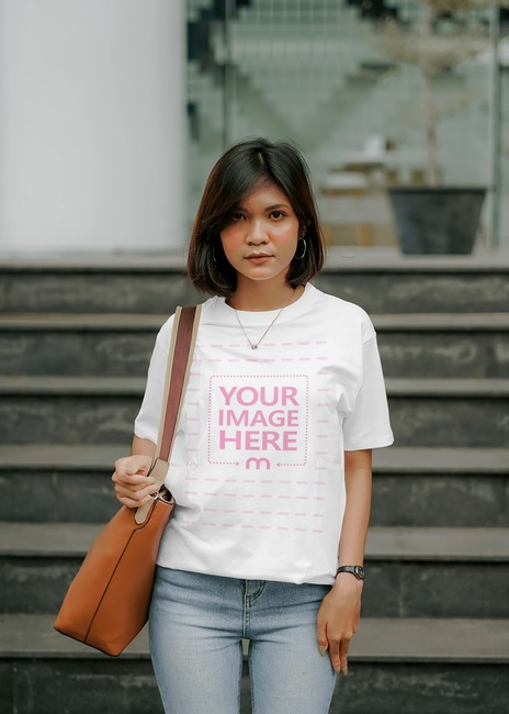 T-Shirt Mockup of Posing With Her Bag preview image