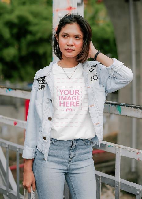 T-Shirt Mockup of a Young Woman Posing at a Bridge preview image