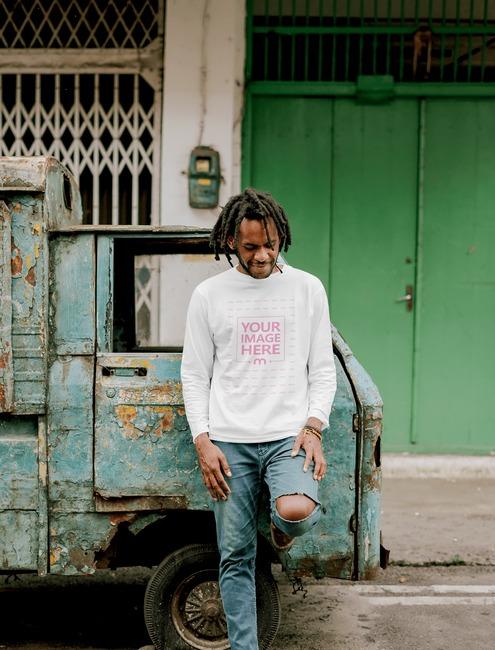 T-Shirt Mockup of a Man Near a Broken Car preview image