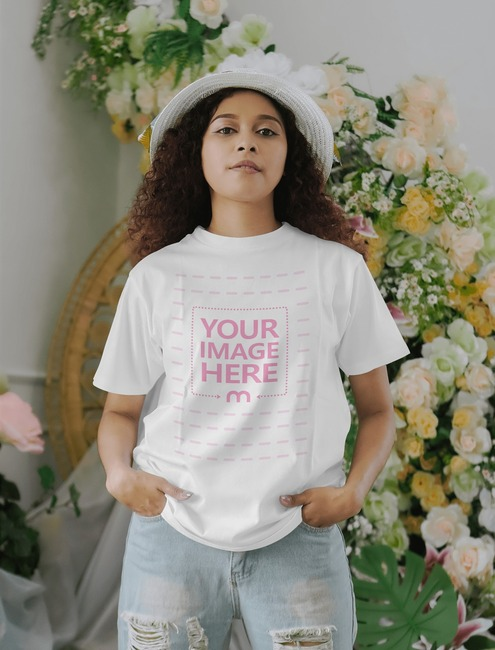 T-Shirt Mockup With Woman Posing on Floral Background preview image