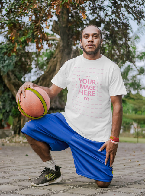 T-Shirt Mockup With Man Holding His Basketball preview image