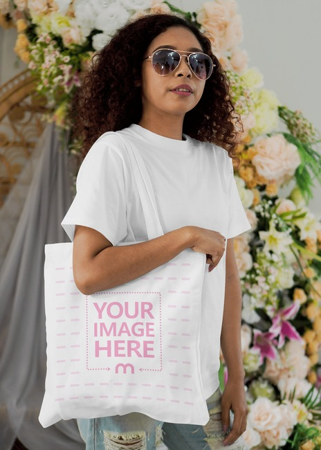 Tote Bag Mockup Featuring a Woman Wearing Glasses preview image