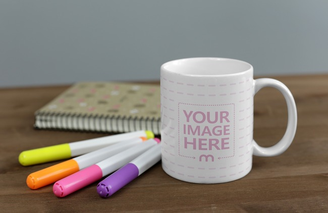 Coffee Mug with Stationery on Wood Desk Mockup preview image