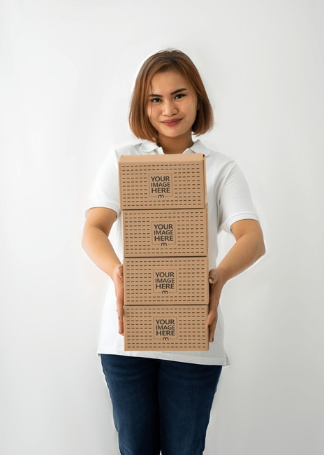 Box Mockup With a Woman Holding Four Small Boxes preview image