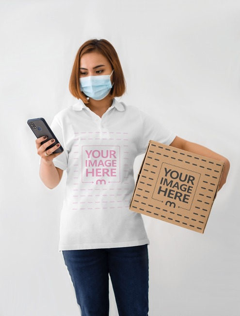 Box Mockup With a Woman Holding a Box on Her Arm While Browsing preview image