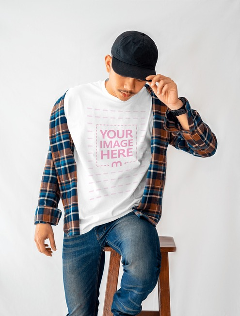 Shirt Mockup of a Man Holding His Hat preview image
