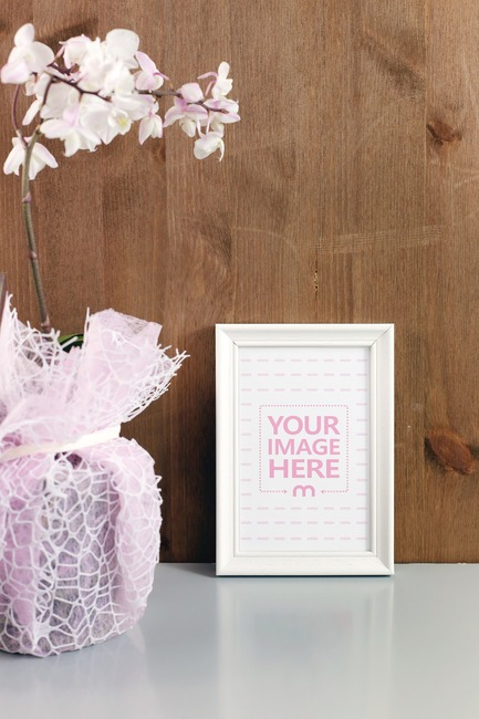 Picture Frame with Plant on Table Mockup Generator preview image