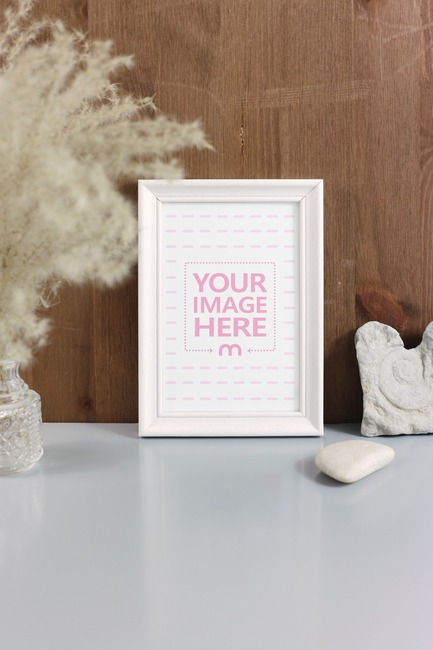 Wood Frame Standing on Decorated Desk Mockup preview image