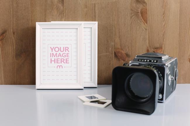 Photo Frames Next to Camera on Table Mockup