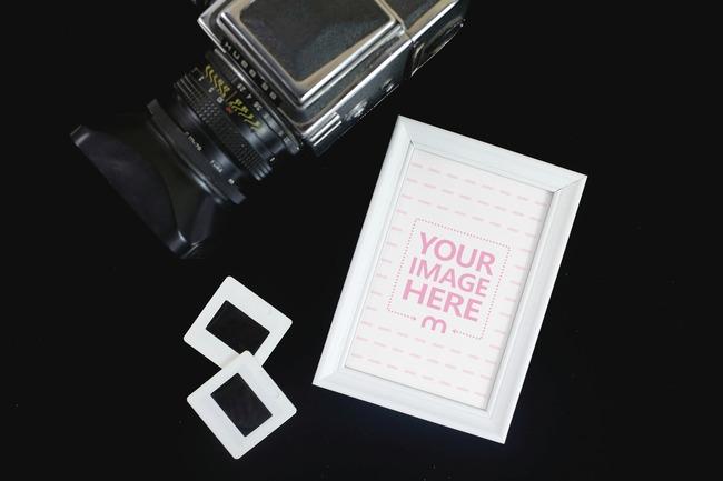 Photo Frame and Camera on Black Background Mockup