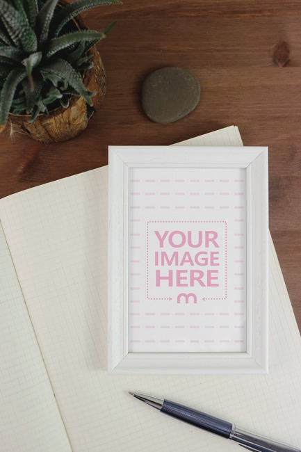 Blank Frame with Notebook and Pen Mockup preview image
