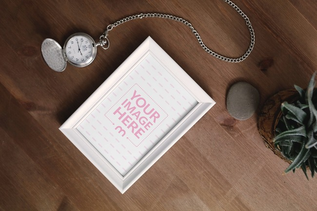 Picture Frame with Pocket Watch on Desk Mockup preview image