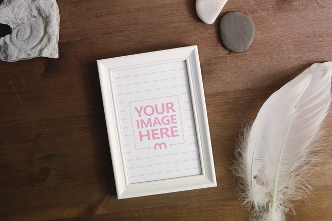 White Frame with Various Objects on Table Mockup preview image