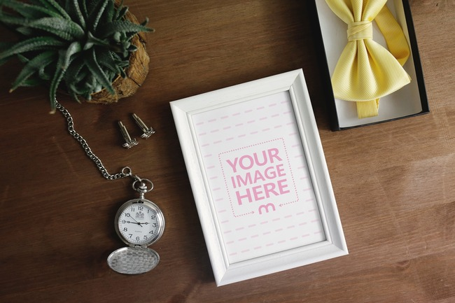 Picture Frame with Pocket Watch and Yellow Bow Tie Mockup preview image