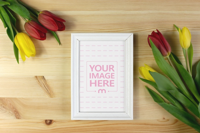 Blank Frame with Flowers on Desk Mockup preview image