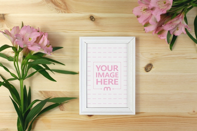 Picture Frame with Flowers on Table Mockup preview image