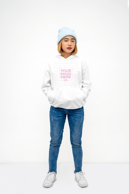Hoodie Mockup With the Model Holding Hands in the Pocket