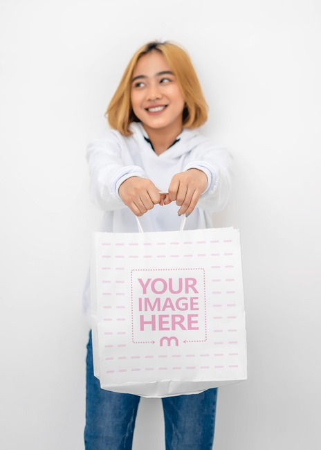 Paper Bag Mockup With Woman Holding the Bag