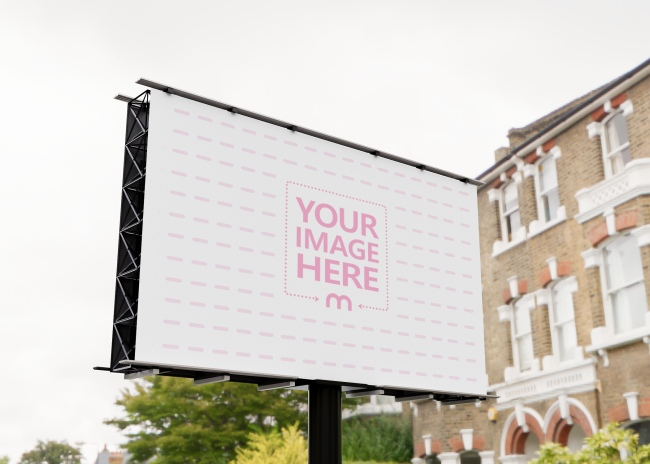 Billboard Mockup With Some Trees and a House