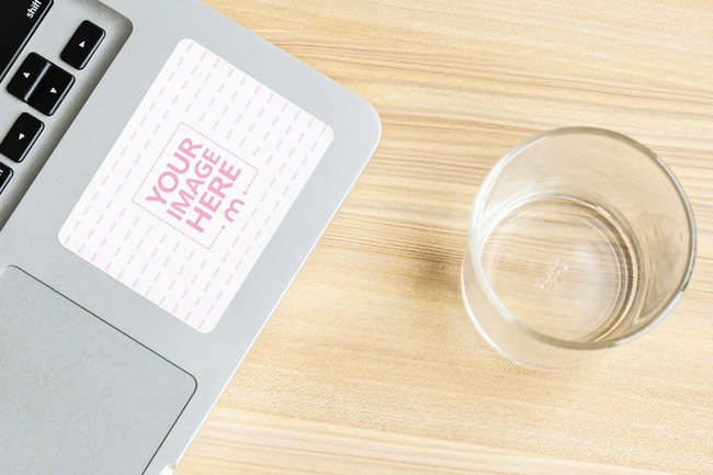 Rectangle Laptop Sticker Next to Glass Cup preview image