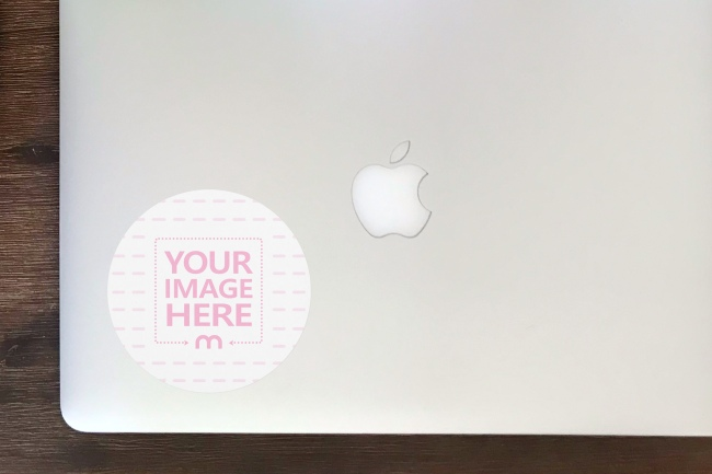 Round Sticker Mockup on Plain Macbook Cover preview image