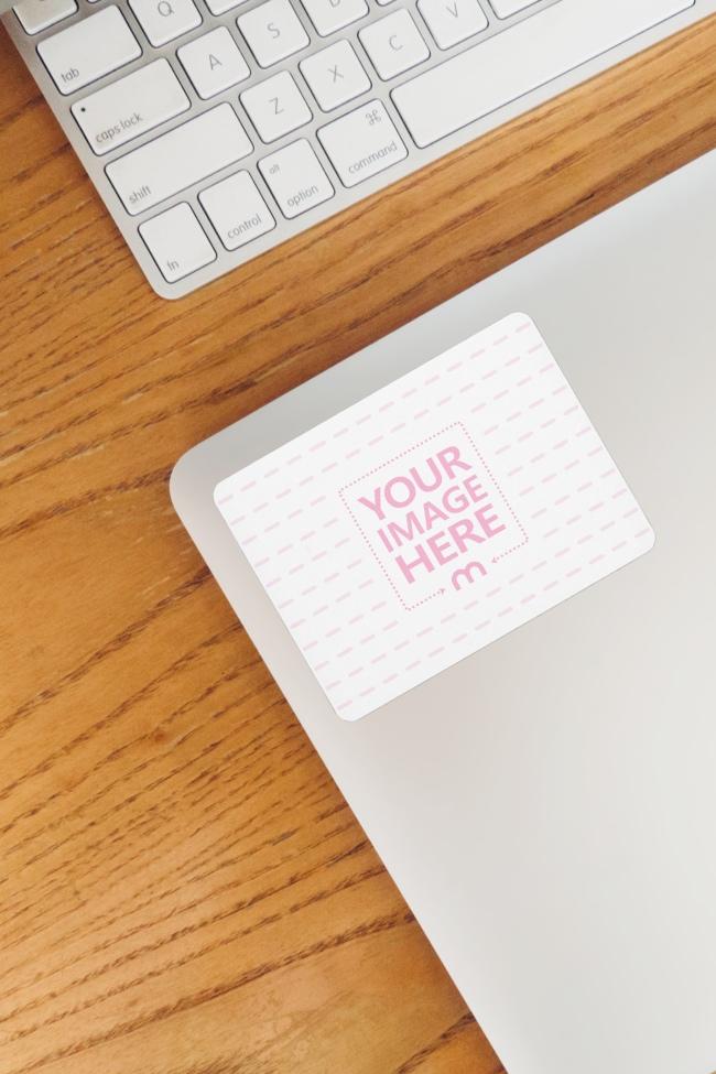 Rectangle Sticker Mockup on Macbook Next to Keyboard