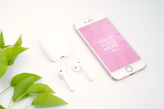 iPhone with Airpods Next to Leaves Mockup preview image