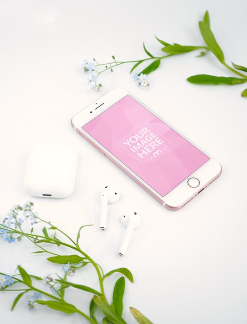 iPhone and Airpods Surrounded by Flowers Mockup Generator preview image