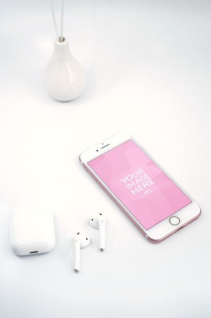 iPhone and Airpods on White Surface with Vase Mockup