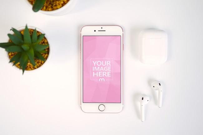 iPhone and Airpods with Plants on White Surface Mockup preview image