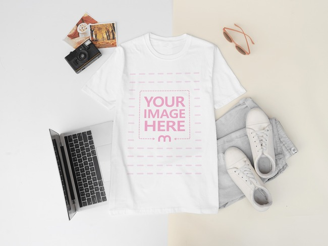 T-Shirt Mockup Laying Against Two Colored Background preview image