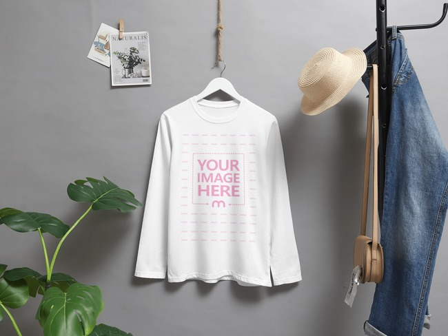 Long Sleeve Shirt Mockup Hanging Against a Gray Paper