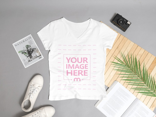Mockup of a Women's V-Neck Shirt Laying on a Gray Background preview image