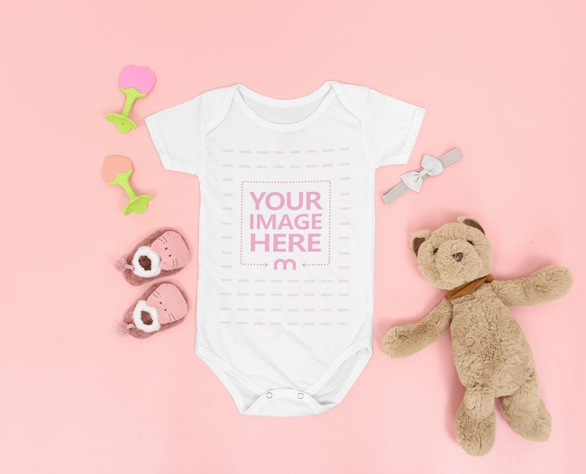 Mockup of a Flat Laid Onesie Featuring Baby Accessories