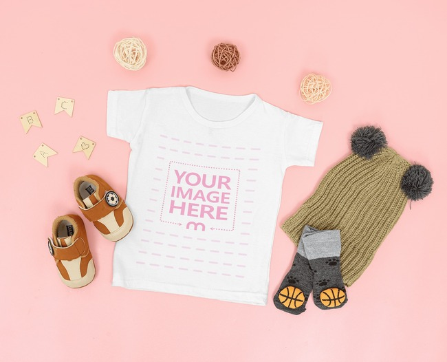 Mockup of a Flat Laid Baby Shirt Surrounded Kids Accessories