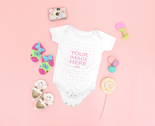 Mockup of a Baby Onesie Surrounded With Girly Accessories