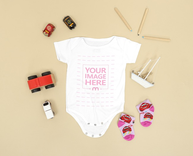 Flatlay Baby Onesie Mockup Flat Laid on a Brown Background