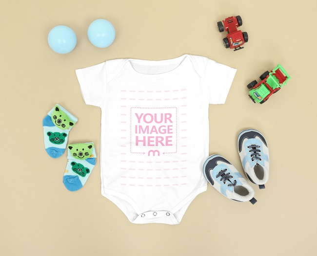 Baby Bodysuit Mockup Laid on the Floor Close by Baby Shoe and Socks