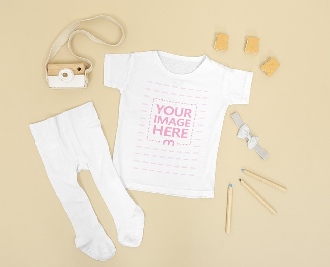Flatlay Mockup of a Baby Onesie With a Pants Beside it