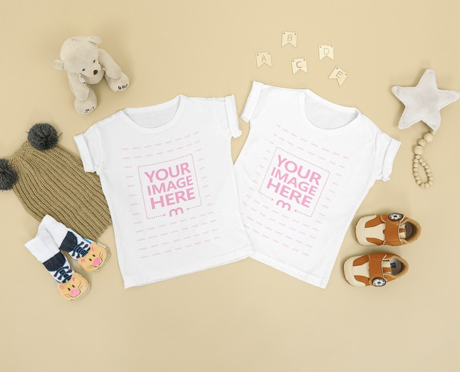 Two Flatlay Baby Shirt Mockup Placed on Top of a Brown Background