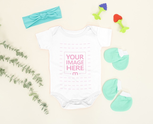 Baby Bodysuit Mockup Laid Over a Light Brown Background