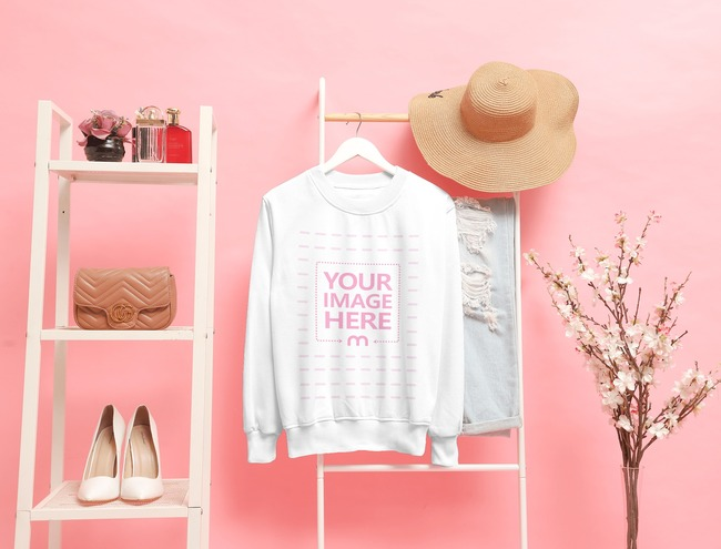 Mockup of a Crewneck Sweatshirt Hanged on a Stair With Pink Background
