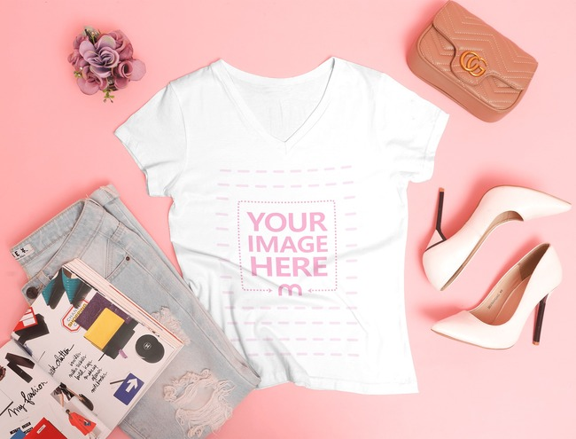 V-Neck Shirt Mockup Laid Over a Pink Background With Some Women Accessories