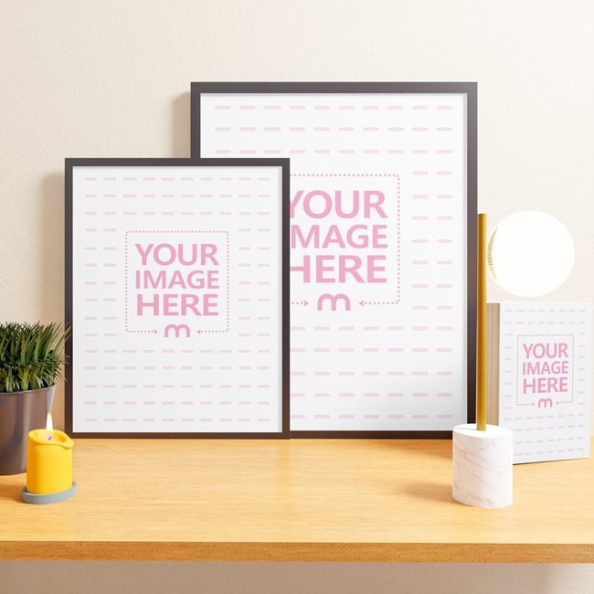 A Pair of two Portrait Canvases and Book Mockup on top of a Desk preview image