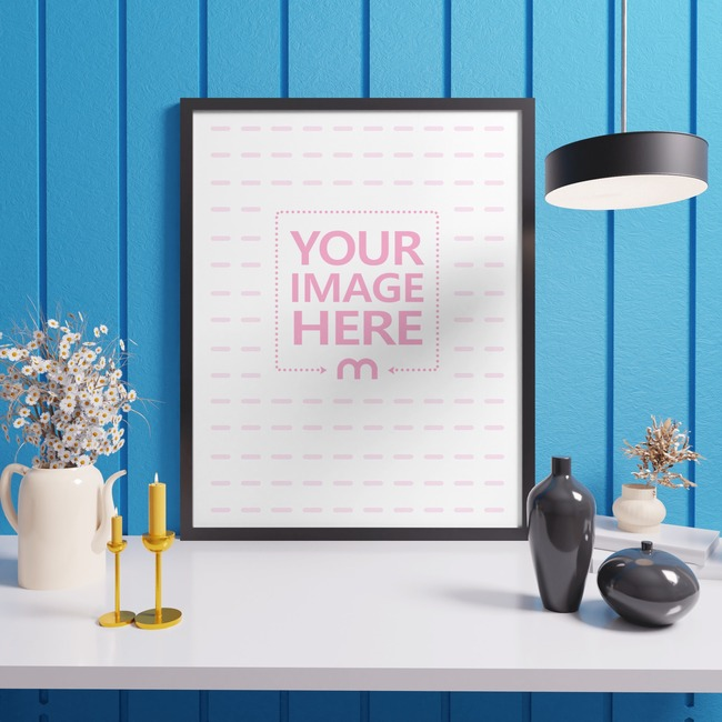 Portrait Canvas Mockup Leaning Back to a Blue Wall