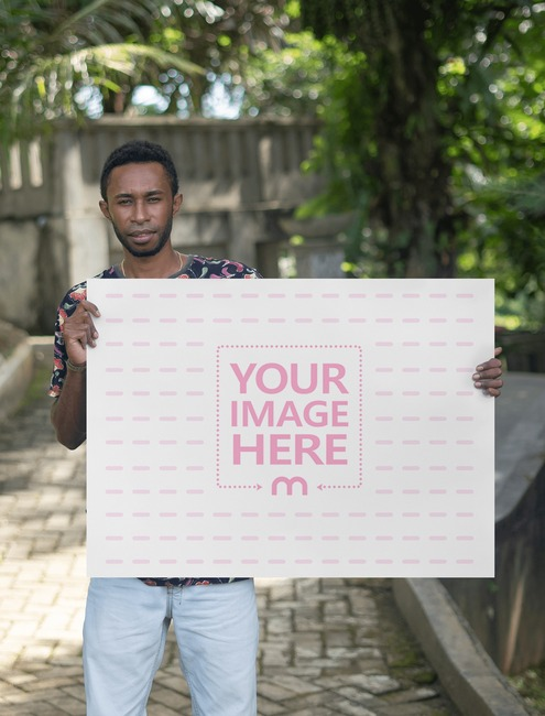 A1 Paper Mockup With a Black Man Holding it on Landscape Position