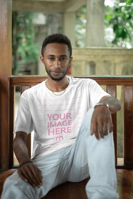 Shirt Mockup With a Sitting Black Black Man