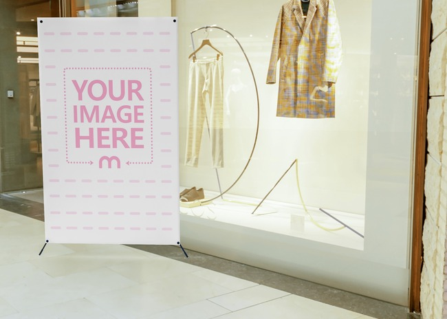 Mockup of a banner in front of a Clothing Store preview image