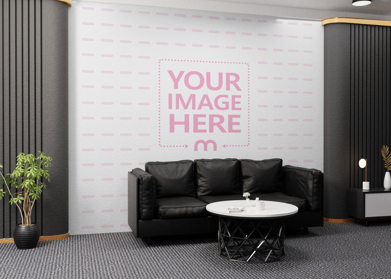 Side View of Wall Art Mockup With a Black Sofa and a White Table in Front of it preview image